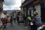Colombia Cycling Camp: Riding through a typical village